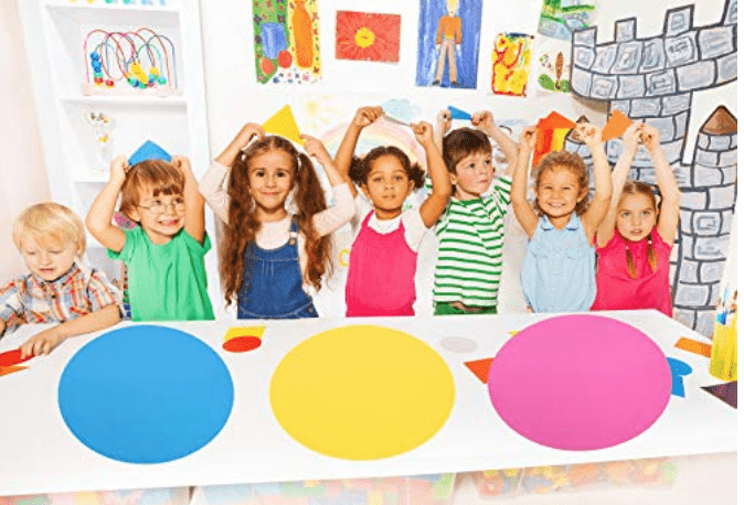 Kids at a table with vinyl dots